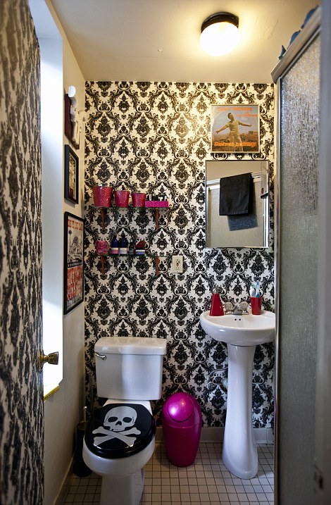 'We had to work within strong limitations which is why color and pattern were essential into creating distinctive areas,' explains Jeanie. Pictured, the tiny lavatory