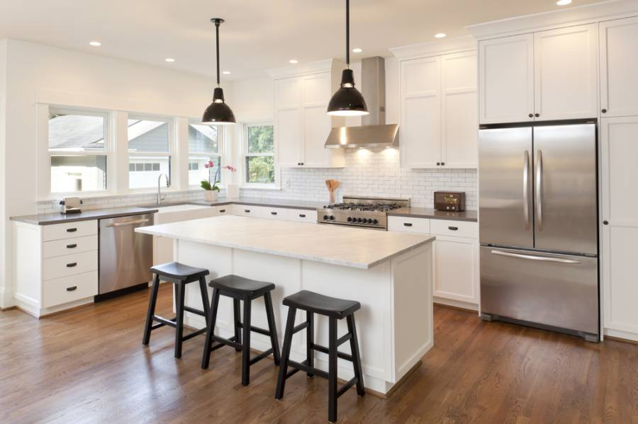 Corner kitchen with island as idea for renovation