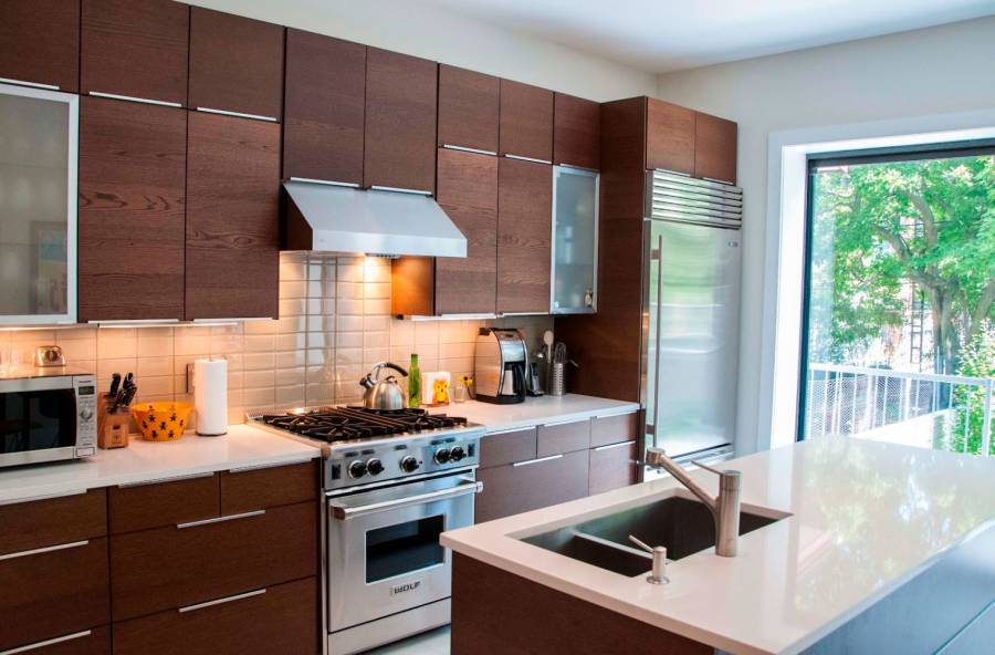 15 - Stainless Steel Range Hood And Sleek Small Island With Sink Idea Also Modern Kitchen Cabinet Design
