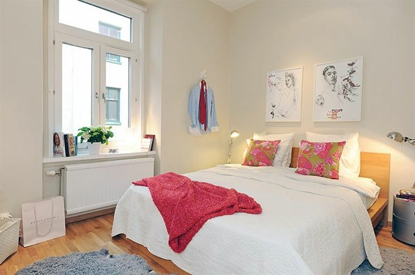 Designed bedrooms in a Scandinavian style full size bed om center cartoons on the wall as a design idea