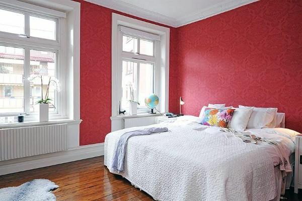 Designed bedrooms in a Scandinavian style redness Tape tablets white duvet