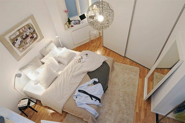 Designed bedrooms in a Scandinavian style view from above large bed and mirror