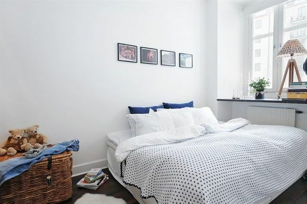 Designed bedrooms in a Scandinavian style white room redness accents