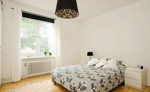 Designed bedrooms in a Scandinavian style bed next to the window white walls