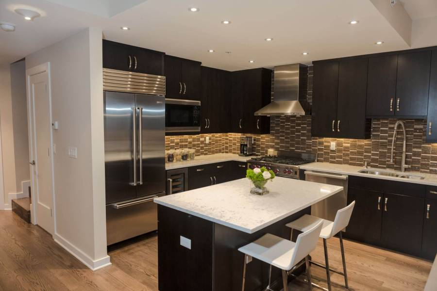 contemporary-kitchen-with-dark-wood-cabinets-and-white-marble-counters-1
