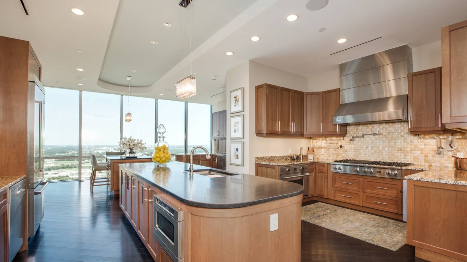 Contemporary kitchen with hardwood floors open to dining room