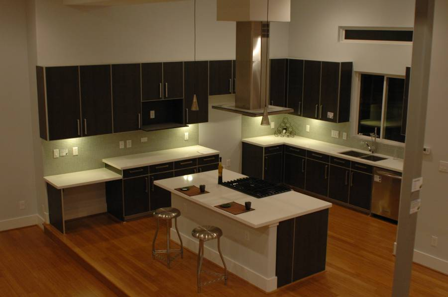 Contemporary Kitchen With High Ceilings Light Wood Floors And Dark Cabinets Homedizz