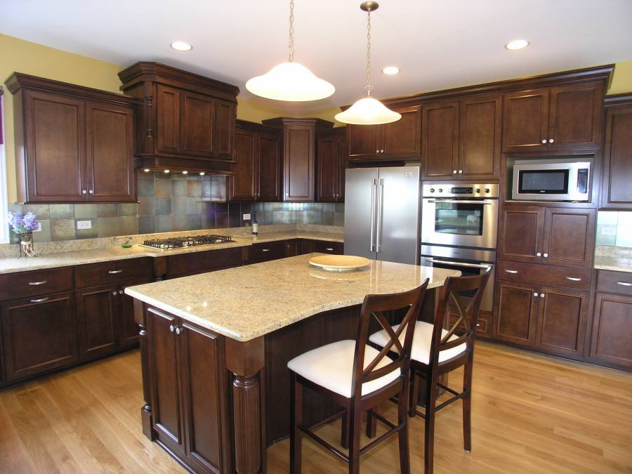 Contemporary Kitchen With Light Granite Counters Dark Wood