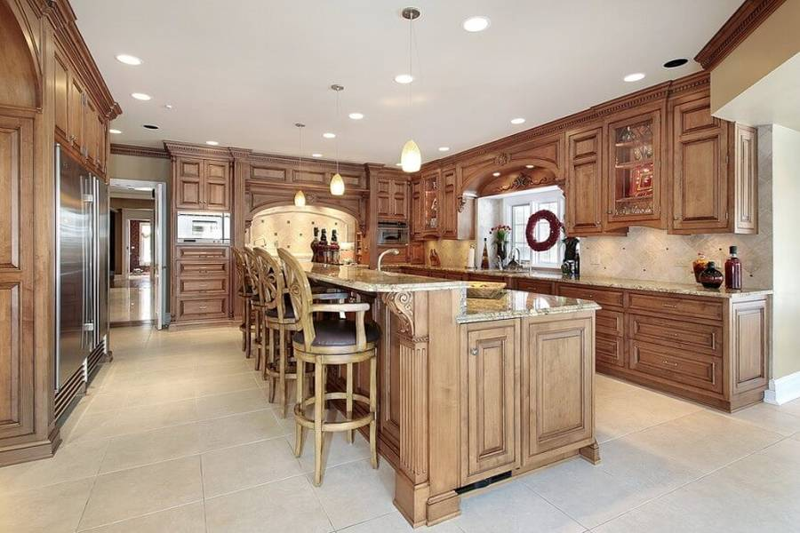 Designer custom kitchen with concrete counter island with dining nook