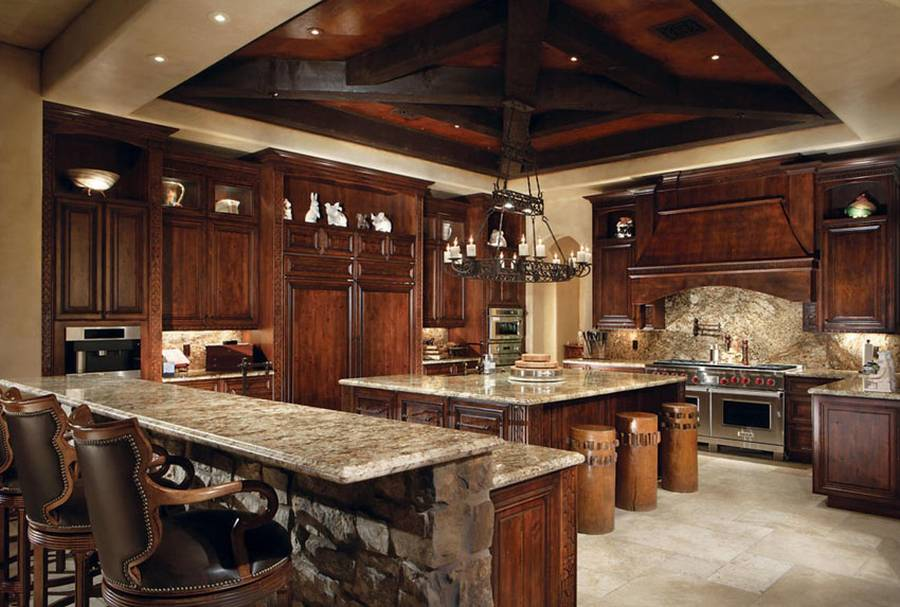 beige granite counters, travertine tile floors and rich wood cabinets