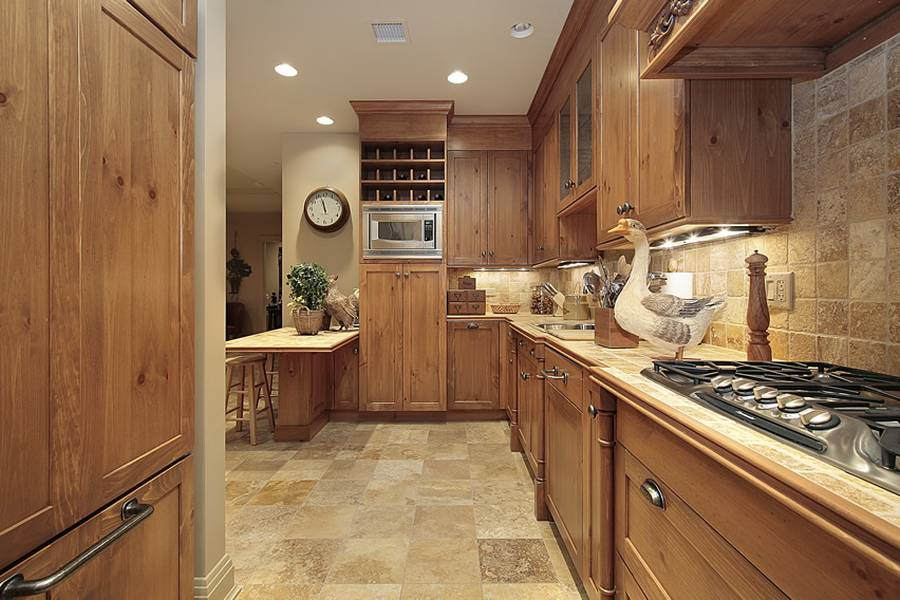 Some words about kitchens with beige granite counters, travertine tile
