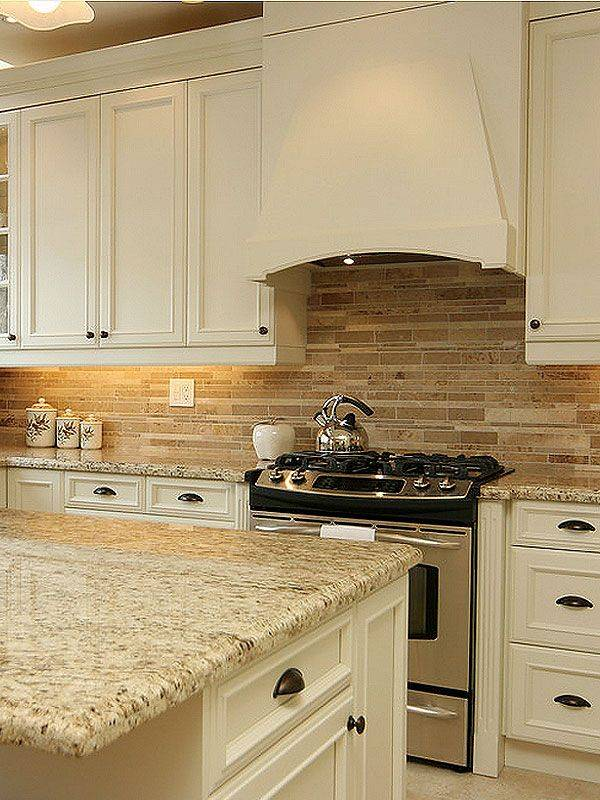 Kitchen with beige granite counters travertine tile floor and rich
