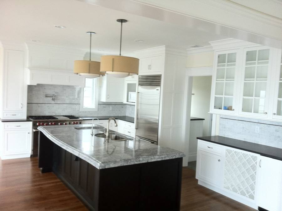 White quartz counter kitchen with dark wood