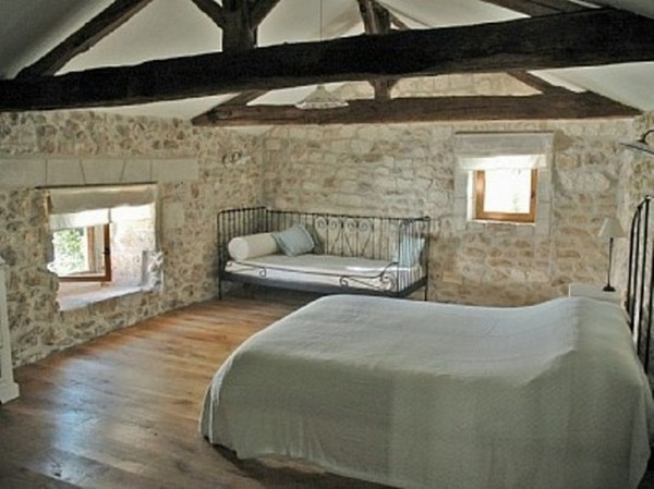 ground stone walls wooden double-bed view