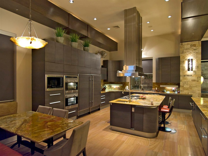 Contemporary kitchen with high ceilings, light wood floors and dark cabinets