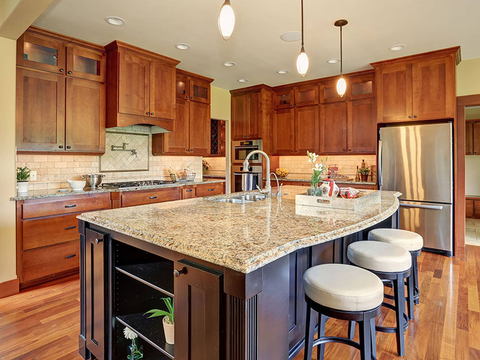 kitchen with light granite counters dark wood island  Homedizz