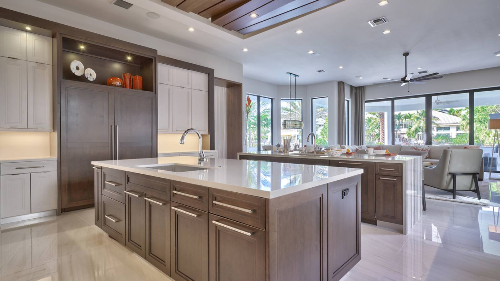 Contemporary Kitchen With Limestone And Rich Wood Cabinetry