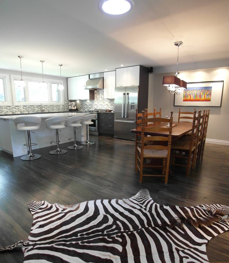Contemporary kitchen with hardwood floors open to dining for Dining room flooring