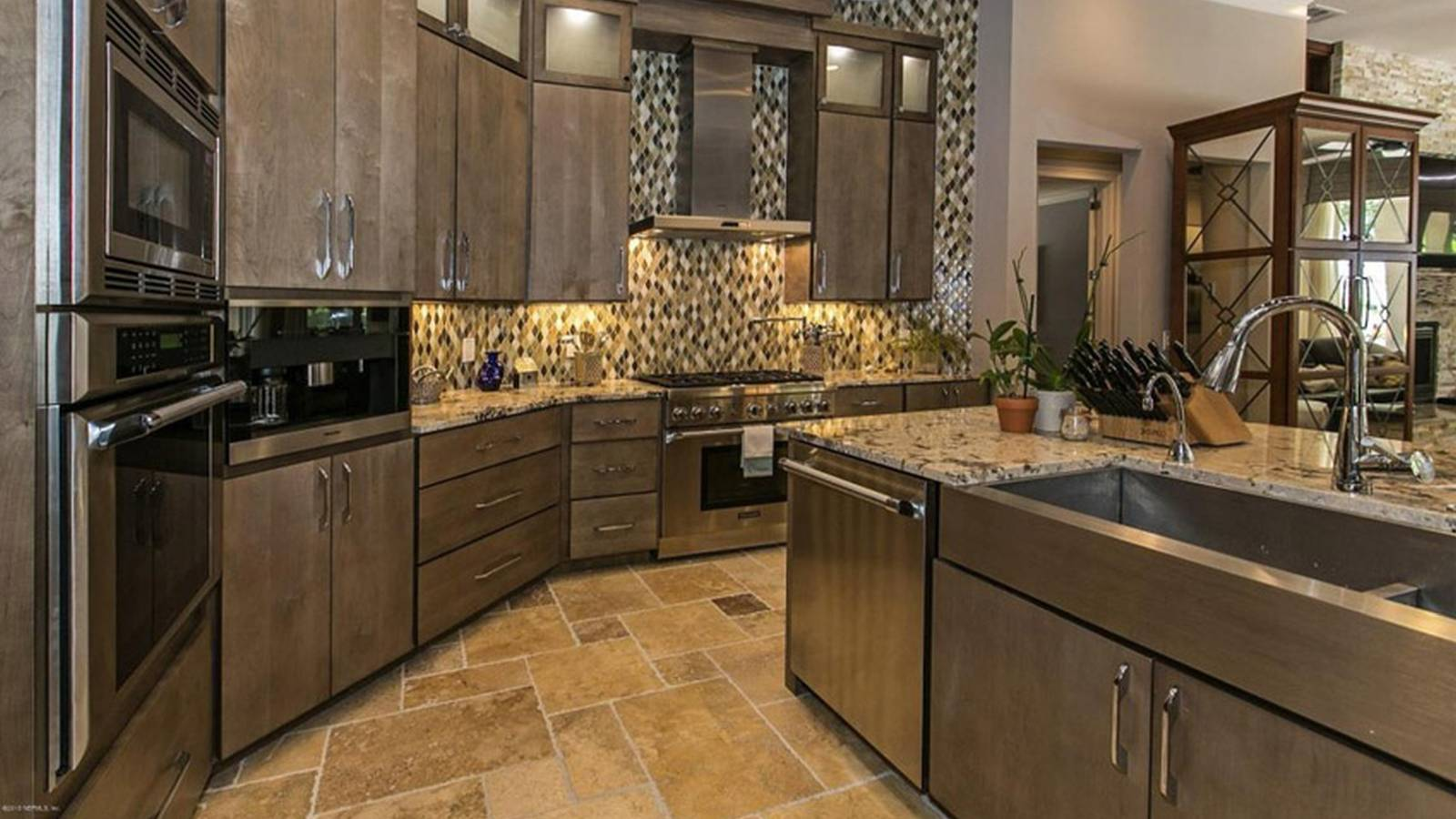 some words about kitchens with beige granite counters travertine tile floors and rich wood cabinets - Beige Kitchen Cabinets