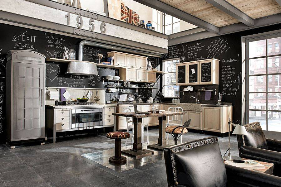Great vintage industrial kitchen with wall art and small island with chairs