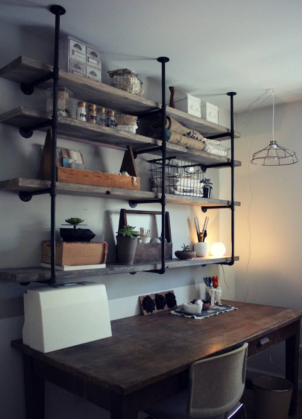 Example of industrial pipe shelving kitchen with vintage table