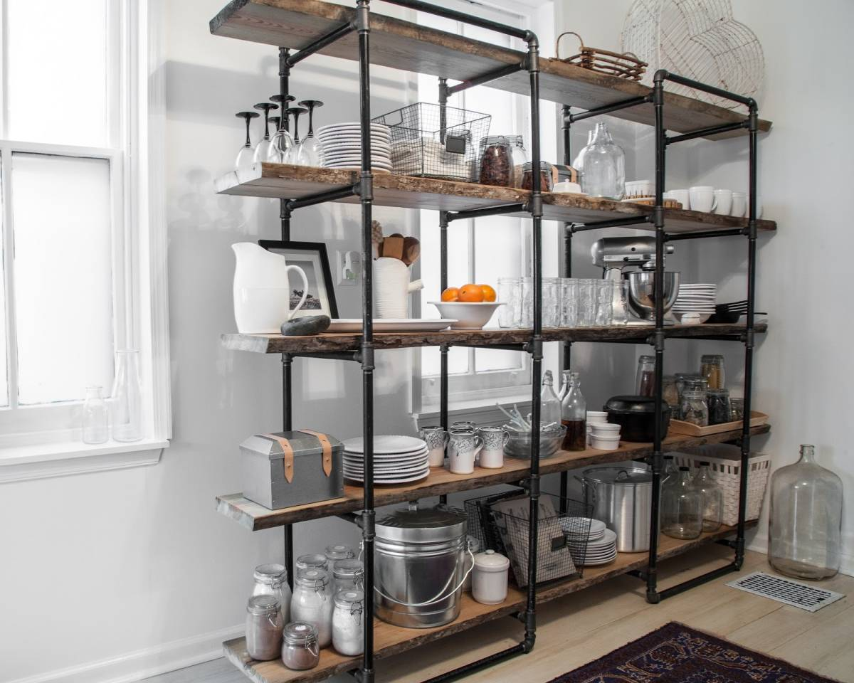 Impressive industrial style kitchen storage made with pipes and rustic shelves