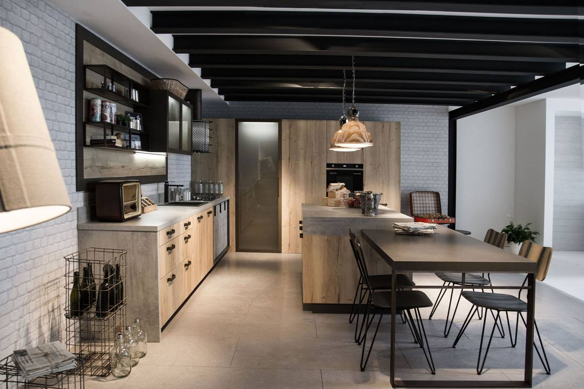 Great and simple urban loft kitchen with ceiling lighting, island and dining area