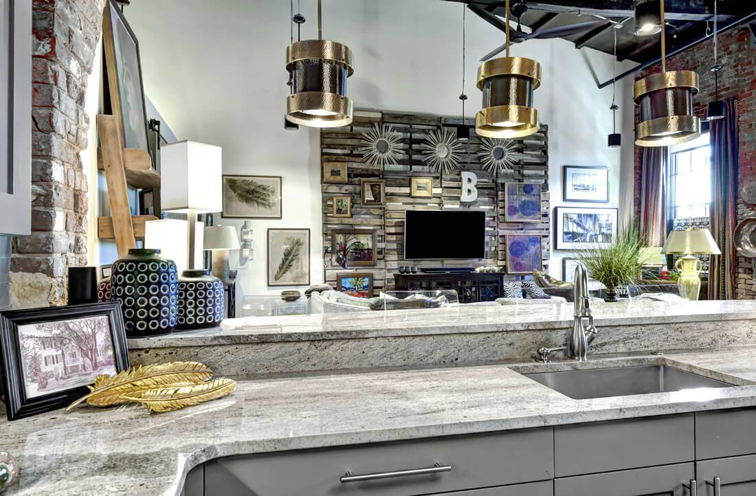 Ideal urban style loft kitchen with wall decor and connected living and dining areas